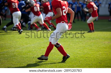 american football game with out of focus players in the background - sports concept, - stock photo