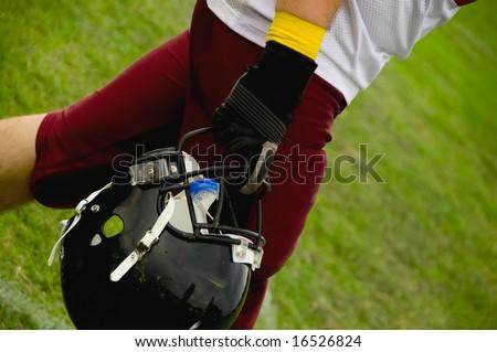 American football helmet in the hand - stock photo