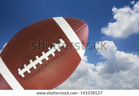 American football in blue sky - stock photo