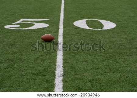 American football near the fifty - stock photo