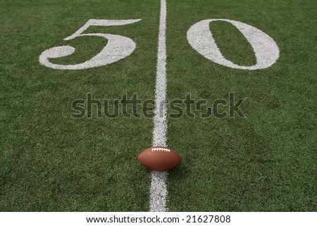 American football near the Fifty yardline - stock photo