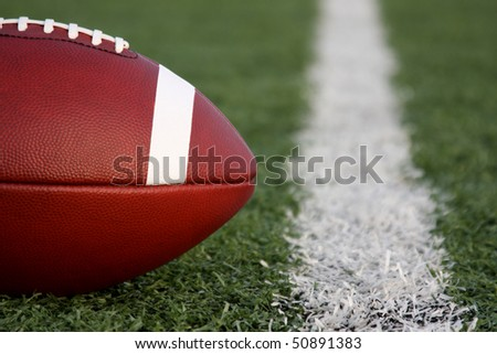 American Football near the yard line - stock photo