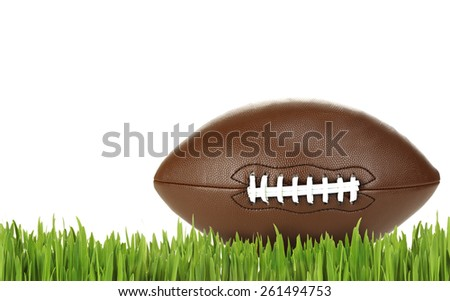 American football on green grass, isolated on white - stock photo