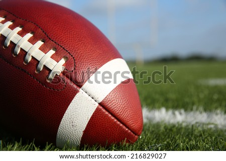 American Football on the Field Close Up - stock photo