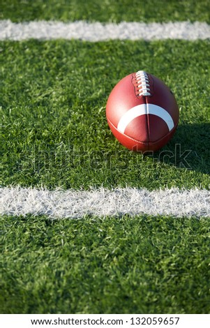 American Football on the Field near yard lines - stock photo