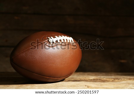 American football on wooden table, close up - stock photo