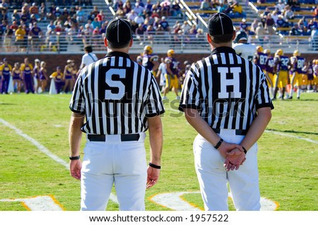 American Football played by young men with game official linesman and side-judge referee - stock photo