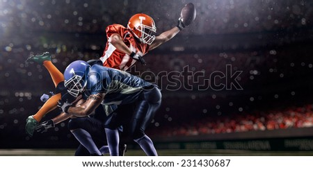 American football player in action on the olympic stadium - stock photo