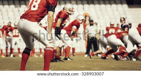 American football player running with the ball - retro styled photo - stock photo