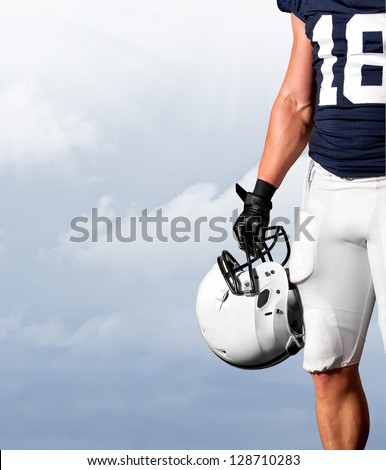 American Football Player Standing Strong - stock photo