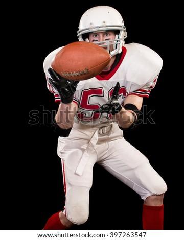 American football player. Studio shot over black. - stock photo