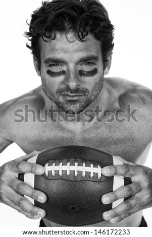 American Football Player with Sweat on White Background Black and White  - stock photo