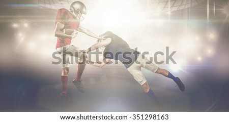 American football players against american football arena - stock photo