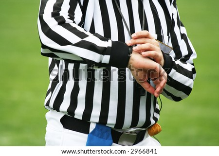 American football Referee looking on time. Sports justice concept - stock photo