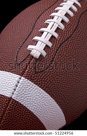 American football up close detail showing laces and stitching - stock photo