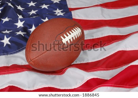 American Football with flag in background - stock photo