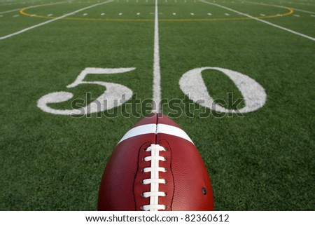 American Football with the Fifty Yard Line and room for copy - stock photo