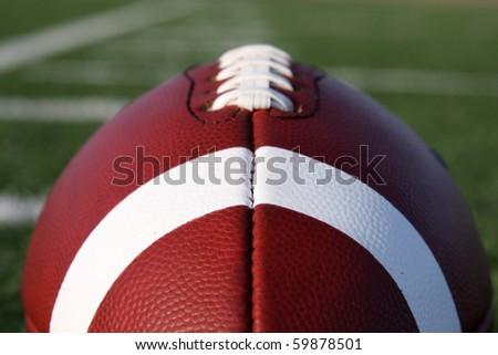 American Football with the Yard Lines Beyond - stock photo