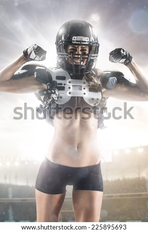 American football woman player in action on the stadium - stock photo