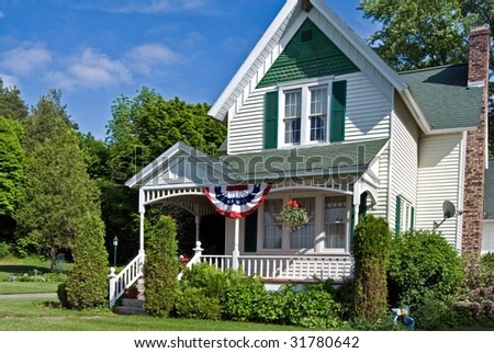 american home with flag bunting - stock photo