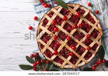 American homemade cherry pie on the table. Horizontal top view - stock photo