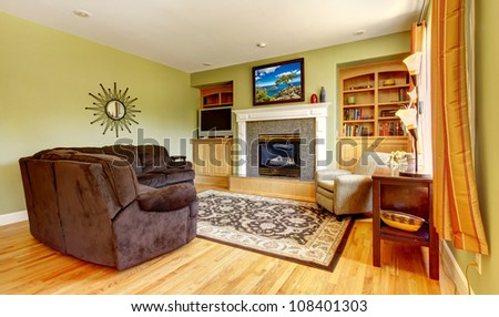 American house classic green room interior with fireplace. - stock photo