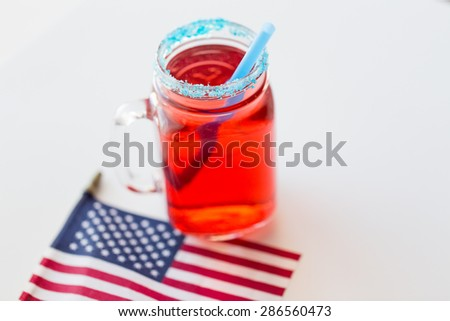 american independence day, celebration, patriotism and holidays concept - close up of juice glass and flag at 4th july party from top - stock photo