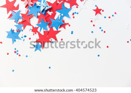 american independence day, celebration, patriotism and holidays concept - red and blue paper stars confetti on american independence day party - stock photo