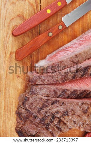 american meat : big rare roast steak on wood isolate on white background - stock photo