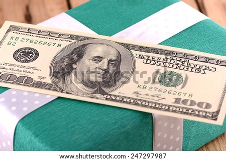 american money with green gift box - stock photo