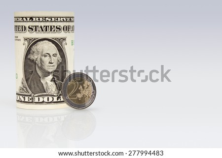 American One Dollar Bank note with a Two Euro coin - stock photo