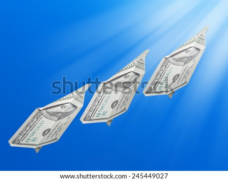 American one hundred dollar banknotes folded into toy planes rising up towards the Sun - stock photo