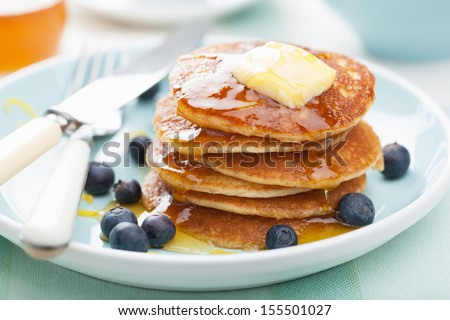 american pancakes with syrup and blueberry  - stock photo