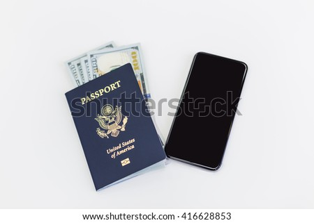 American passport with dollars inside and blank smartphone on white background. Mock up - stock photo
