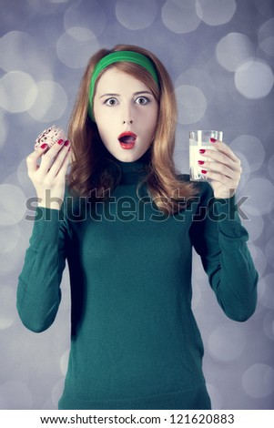 American redhead girl with milk and cake. Photo in 60s style - stock photo