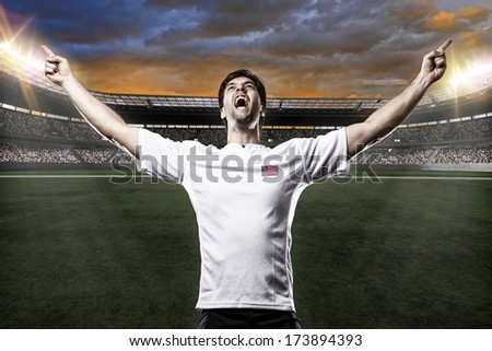 American soccer player, celebrating with the fans. - stock photo