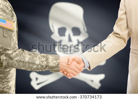 American soldier in uniform and civil man in suit shaking hands with flag on background - Jolly Roger - symbol of piracy - stock photo