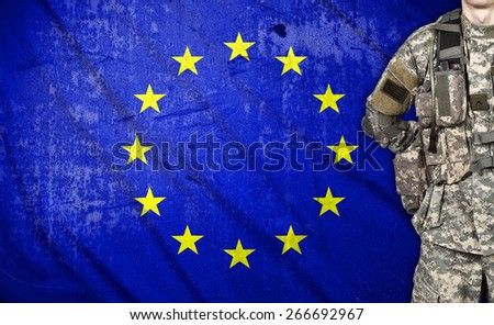 American soldier with European Union flag on background - stock photo