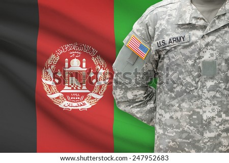 American soldier with flag on background - Afghanistan - stock photo