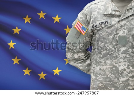 American soldier with flag on background - European Union - EU - stock photo
