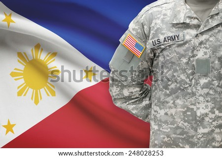 American soldier with flag on background - Philippines - stock photo