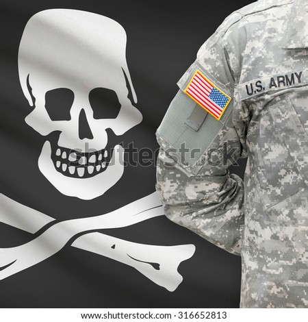 American soldier with flag on background series - Jolly Roger - symbol of piracy - stock photo