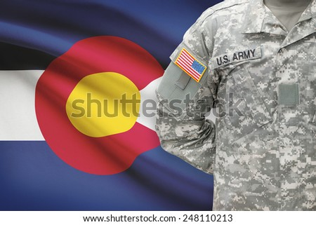 American soldier with US state flag on background - Colorado - stock photo