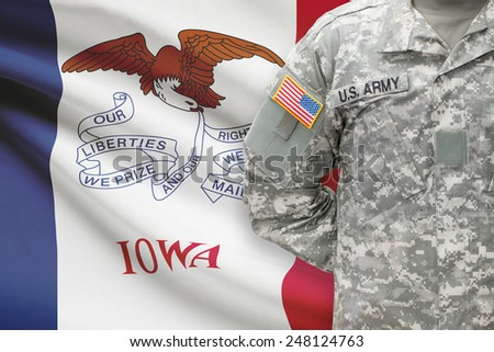 American soldier with US state flag on background - Iowa - stock photo