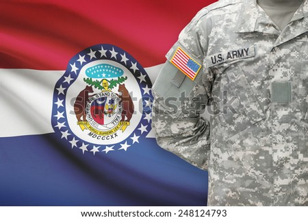 American soldier with US state flag on background - Missouri - stock photo
