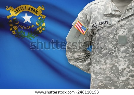 American soldier with US state flag on background - Nevada - stock photo