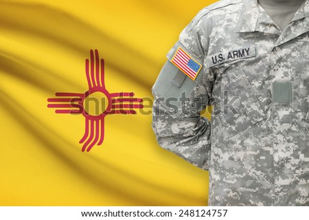American soldier with US state flag on background - New Mexico - stock photo