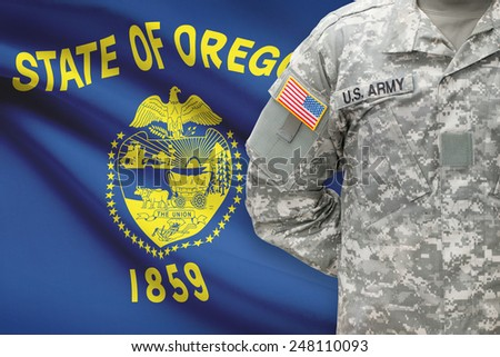 American soldier with US state flag on background - Oregon - stock photo