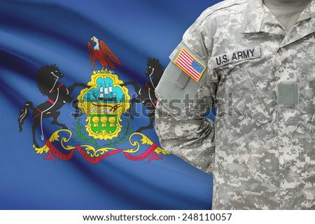 American soldier with US state flag on background - Pennsylvania - stock photo