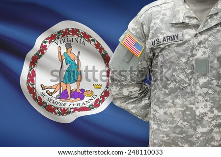 American soldier with US state flag on background - Virginia - stock photo